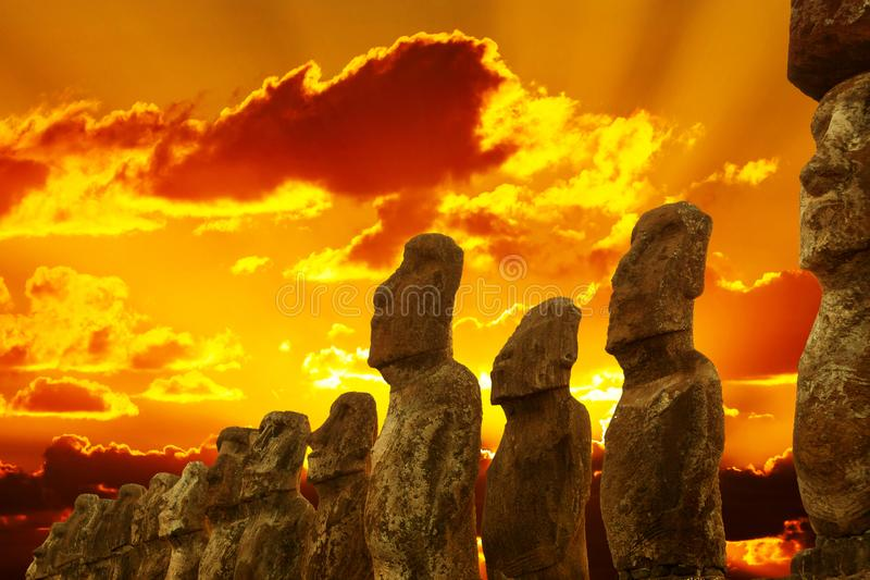 Standing moais at Ahu Tongariki in Easter Island at dramatic gloden sunset stock photos