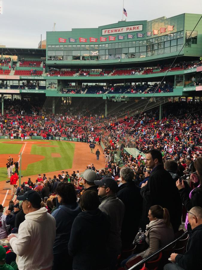 Standing for National Anthem at Fenway Park. The crowd at Fenway Park rises for the National Anthem prior to a game against the Baltimore Orioles stock photos