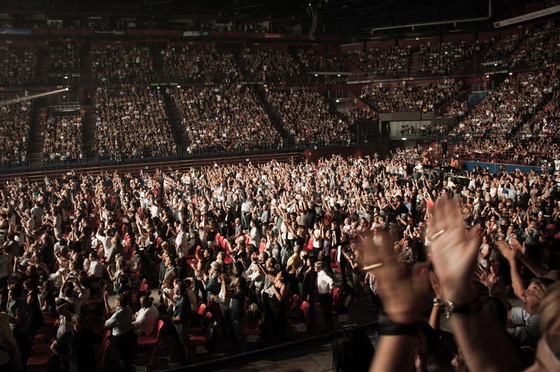 Standing ovation. An enthusiastic crowd clapping hands during a concert stock photo