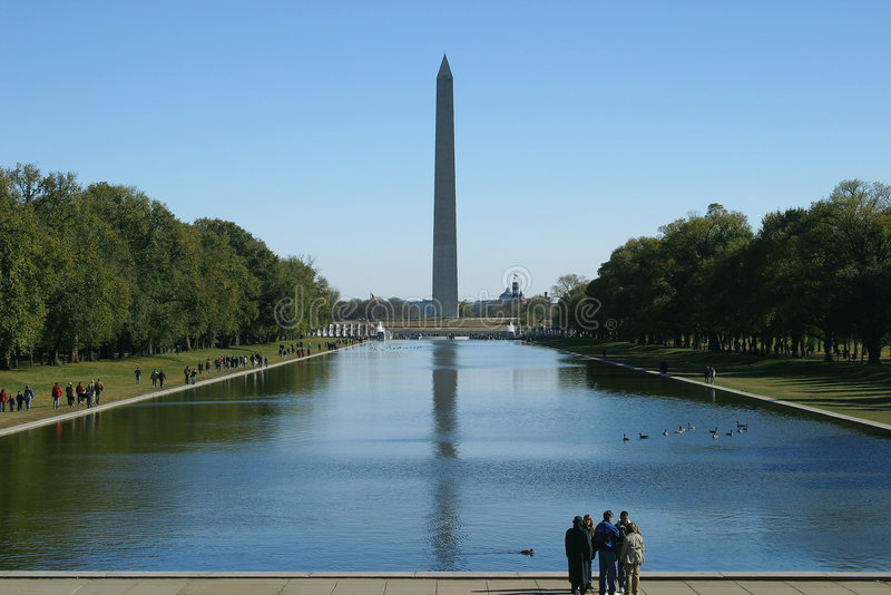 Standing at the reflecting pool stock photos