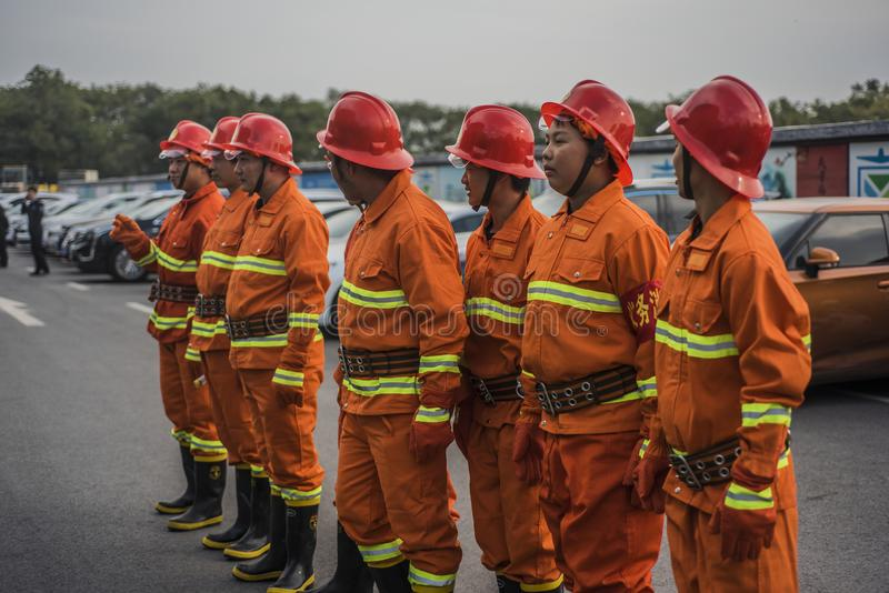 Standing in a row of firefighters stock photography