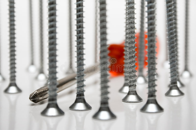 Download Standing Screws & Screwdriver Stock Image - Image of metal, background: 472289