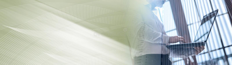 Senior businessman working on laptop, double exposure, light effect; panoramic banner stock image