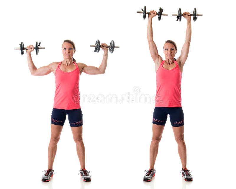 Standing Shoulder Press. Exercise. Studio shot over white royalty free stock photography