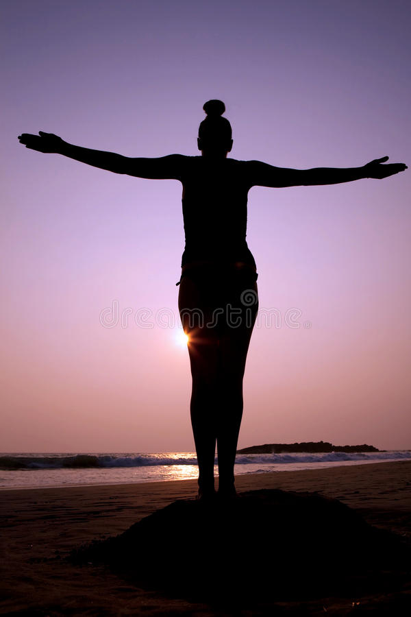 Standing silhouette pose. Freedom/strength stock image