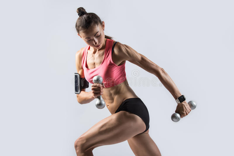 Standing Single Arm Dumbbell Row royalty free stock photography