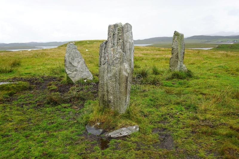 Standing stones on Lewis Island, Outer Hebrides. A rough circle of ancient Neolithic standing stones on Lewis Island in Scotland`s Outer Hebrides. The stones are stock image