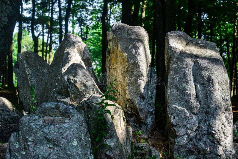Standing Stones with the Sun Shining through the trees. Of the Rib Mountain State Park, Wisconsin forest. Rock made of very hard metamorphic rock called royalty free stock photos