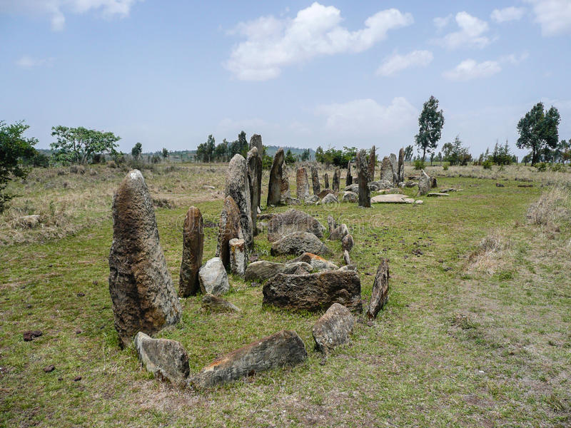 Standing stones. Tiya in southern Ethiopia is an archeological site, which is distinguished by 36 standing stones or stelae. They are marking a large stock photo