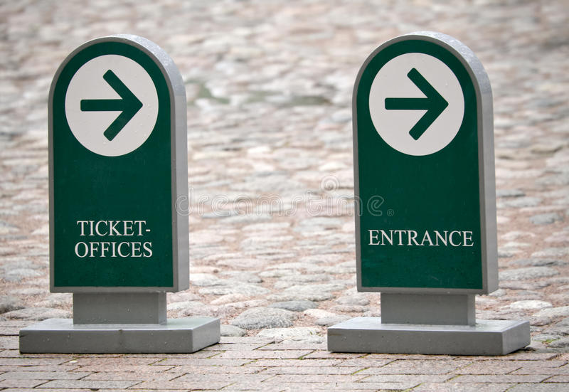 Standing street signs with arrows to the entrance. Standing street signs with arrows to entrance and ticket-offices of the museum royalty free stock photography