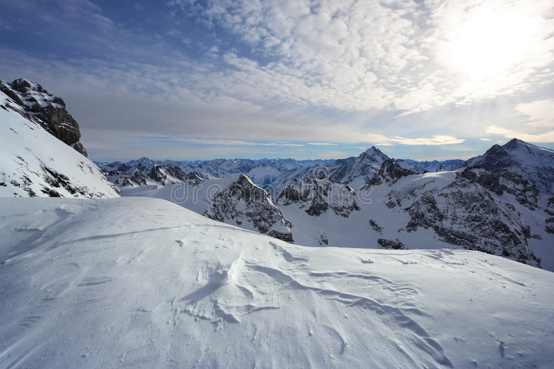 Standing on Titlis of the Swiss alps royalty free stock images