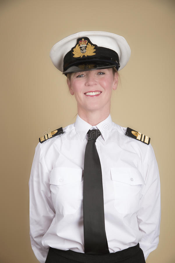 Standing to attention a female naval officer royalty free stock photo
