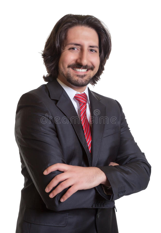 Standing turkish businessman with crossed arms stock image