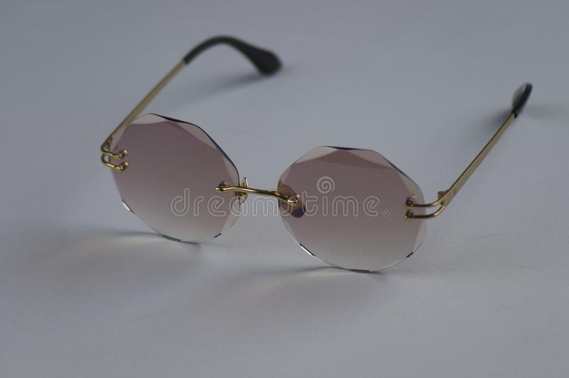 Standing on a white background condition sunglasses stock image