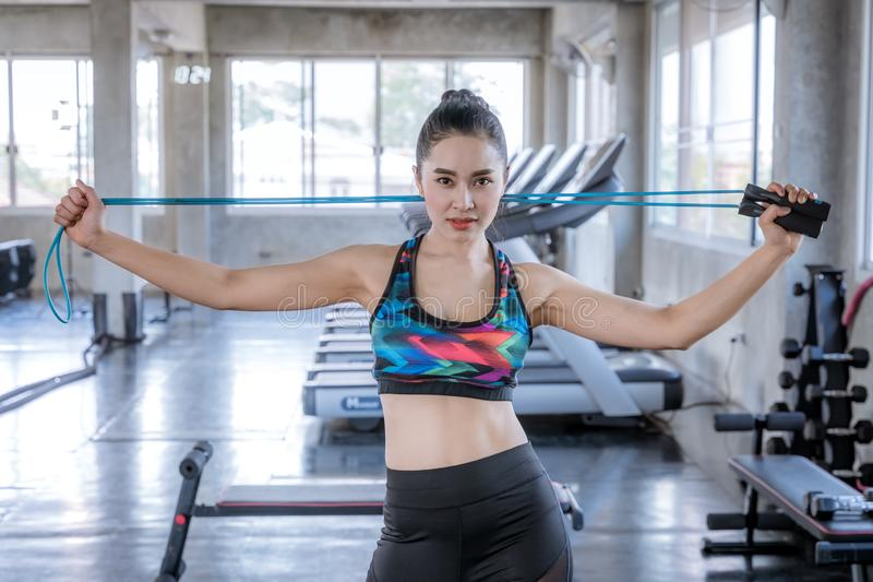 Standing woman holding a rope in the gym stock images