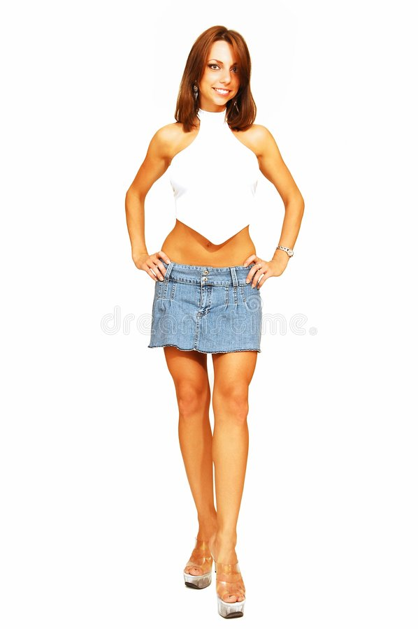 Standing woman in short jeans skirt.