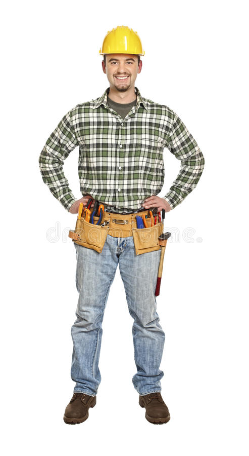 Standing young handyman royalty free stock photo