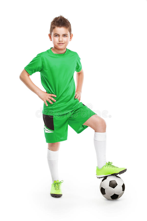 Standing young soccer player with football stock photography