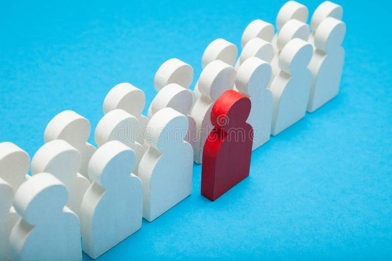 Standout rebel people figure. Unique and individual concept royalty free stock photo