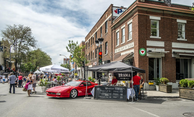 Stands anr Rars. Street fair in Little Italy, Montreal. Little Italy French: La Petite-Italie; Italian: Piccola Italia is a neighbourhood in Montreal, Quebec royalty free stock image