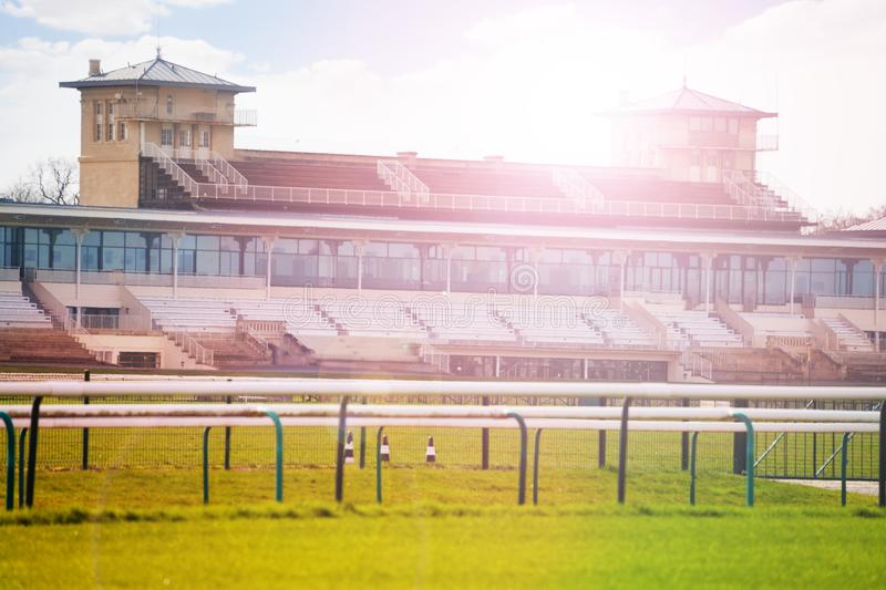 Stands building and racecourse, Chantilly, France. Stands` building with racecourse of horse training centre at Chantilly, France stock images