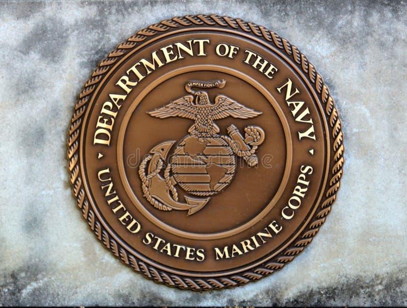 Stany Zjednoczone dział marynarka wojenna żołnierzy piechoty morskiej korpusów moneta w betonowej płycie fotografia royalty free