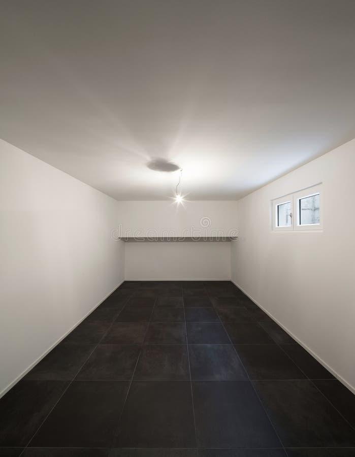 Stanza con il nero piastrellato del pavimento fotografie stock libere da diritti