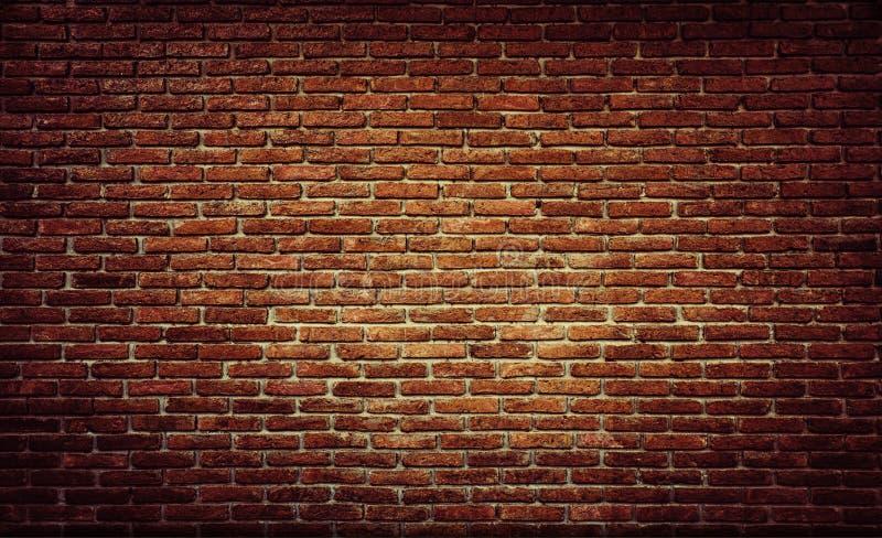 Stanza vuota con il muro di mattoni rosso ed il pavimento di legno immagine stock