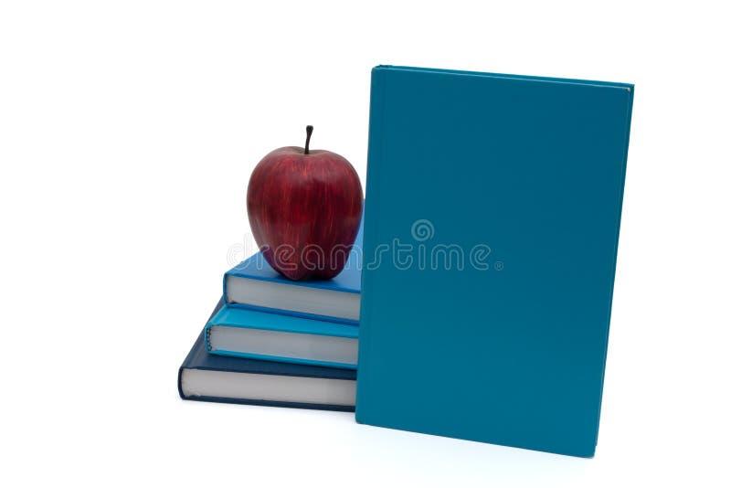 Stapel Boeken met een appel stock afbeeldingen