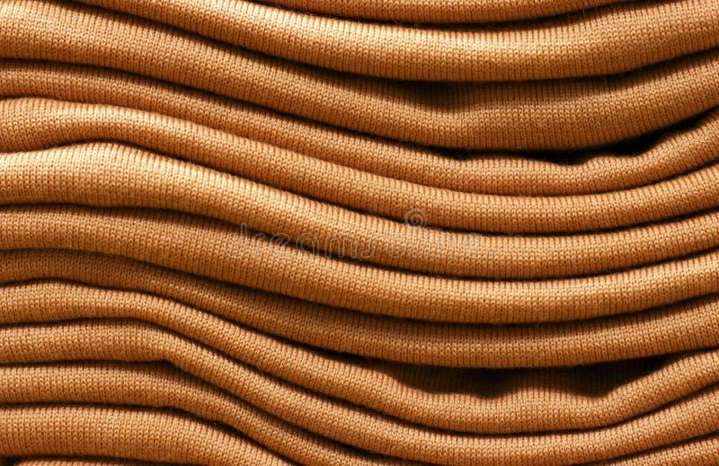 Stapel braune woolen gestrickte Strickjacken Nahaufnahme, Beschaffenheit, backgr stockbilder