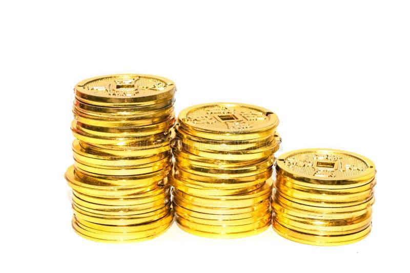 Stapel chinesische goldene Münzen lizenzfreie stockfotografie