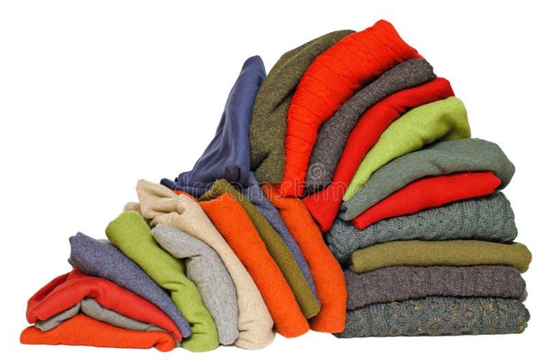 Stapel de winter of de dalingssweaters van mensen royalty-vrije stock afbeelding