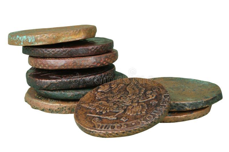 Stapel der alten Münzen stockfotos