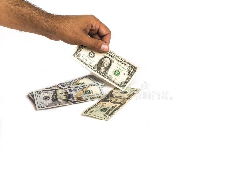 Stapel des Geldes in der Hand von hundert Dollarscheinen mit einen und zwanzig Dollaranmerkungen lizenzfreies stockbild