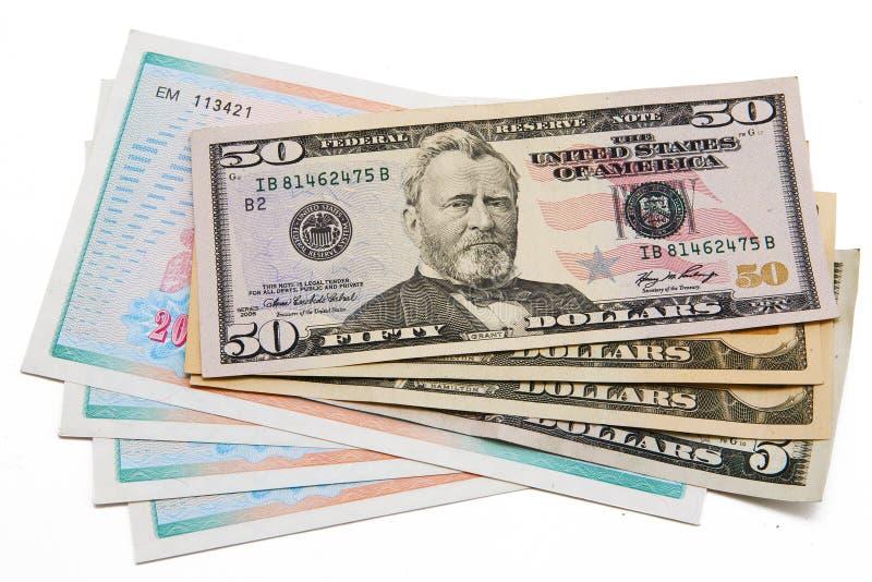 Stapel Dollarscheine Vereinigte Staaten und Anteile lizenzfreie stockfotos