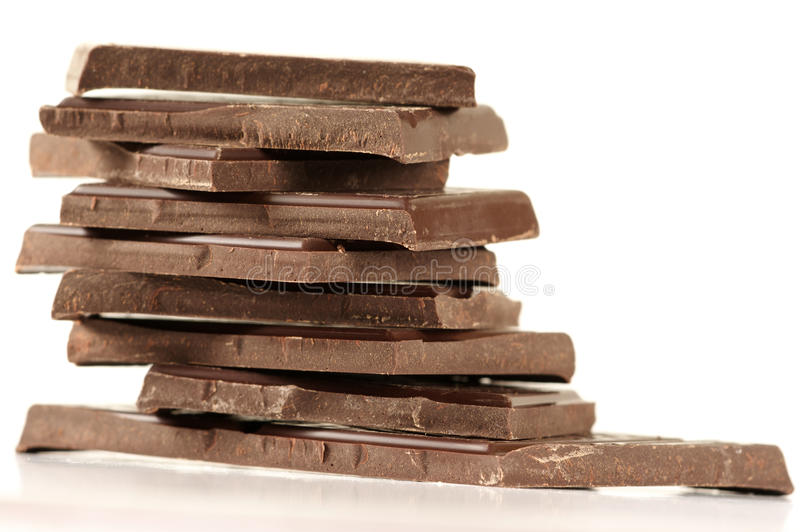 Stapel dunkle Schokolade stockbild