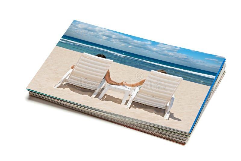 Stapel geïsoleerde vakantiefoto's royalty-vrije stock afbeeldingen