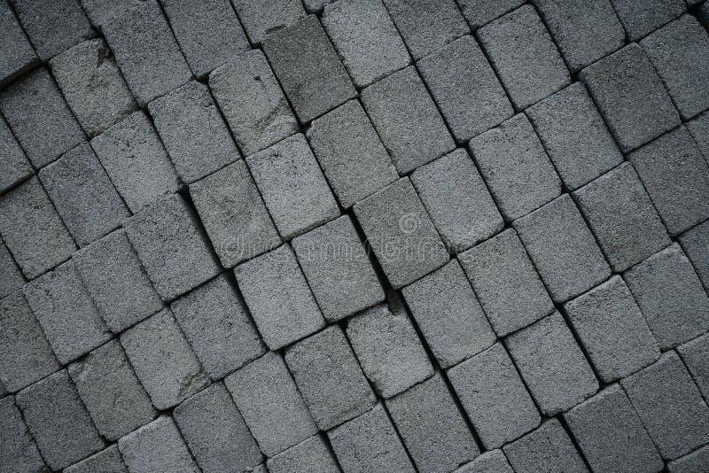 Stapel graue Bauziegelsteine lizenzfreies stockfoto