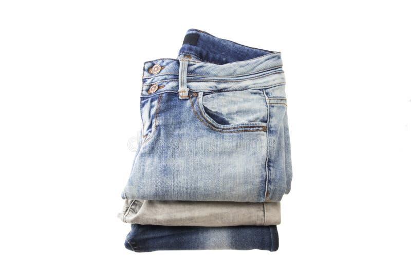 Stapel jeans voor vrouwen op een witte backround royalty-vrije stock foto's