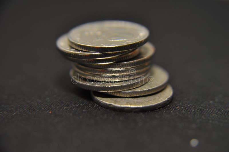 Stapel muntstukken stock foto's