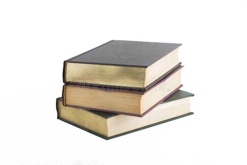 Stapel oude boeken die op wit worden geïsoleerdn royalty-vrije stock afbeeldingen