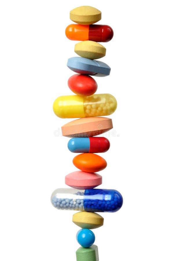 Stapel pillen en capsules stock afbeeldingen