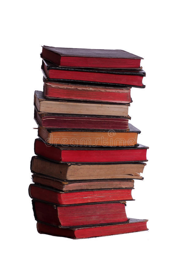 Stapel sehr alte Bücher mit roten Seiten lizenzfreie stockfotografie