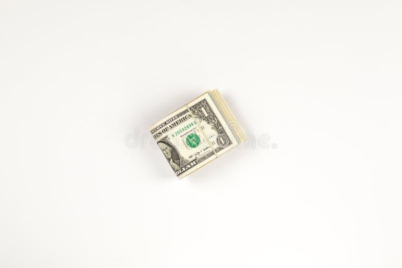 Stapel USA 1 Dollar lokalisiert auf weißem Hintergrund stockbilder