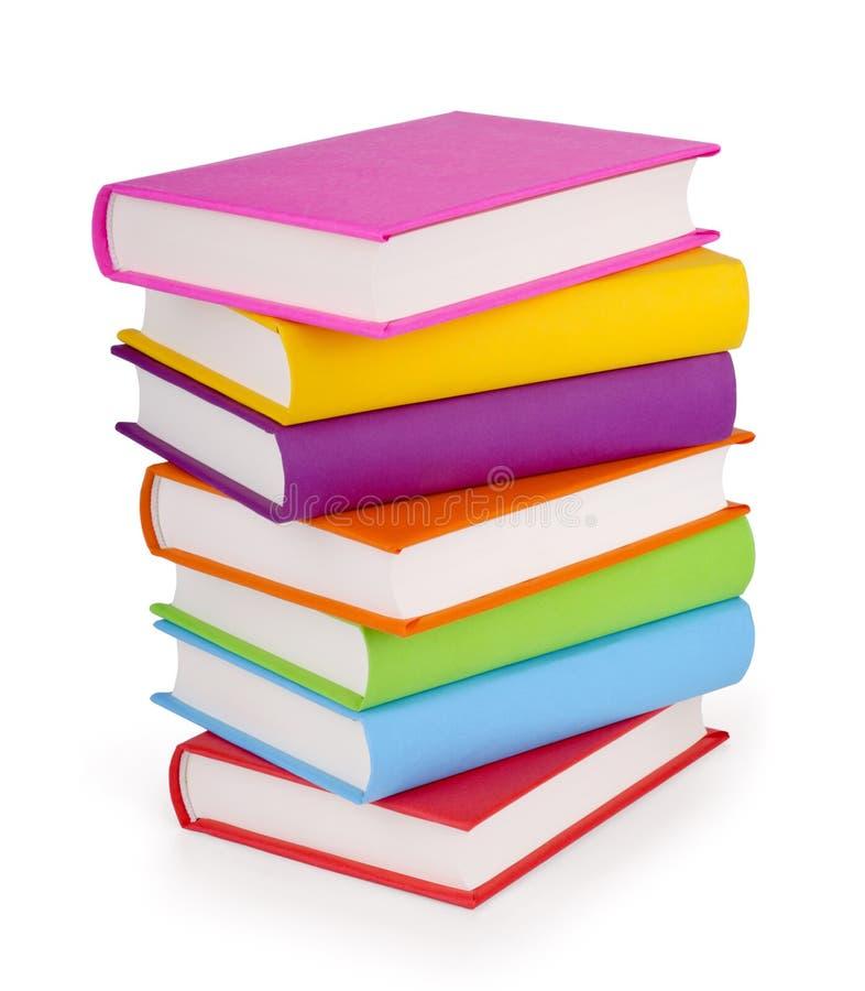 Stapel van boeken die op wit worden geïsoleerdi royalty-vrije stock afbeeldingen
