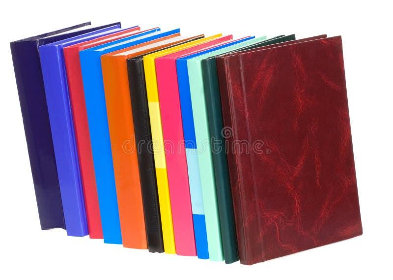 Stapel van boeken die op wit worden geïsoleerdz stock afbeelding
