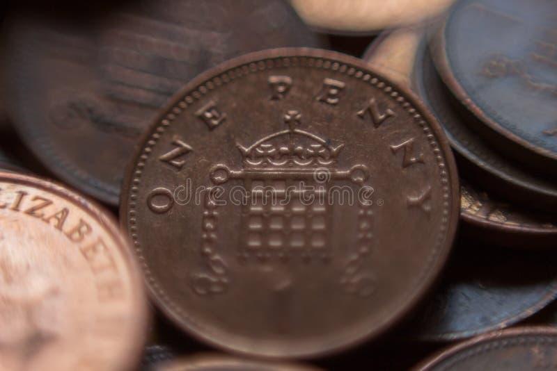 Stapel van Britse 1 pence muntstukken stock fotografie