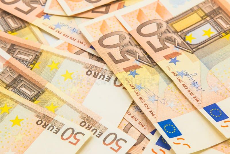 Stapel van 50 euro geldbankbiljetten, bedrijfsachtergrond stock afbeelding