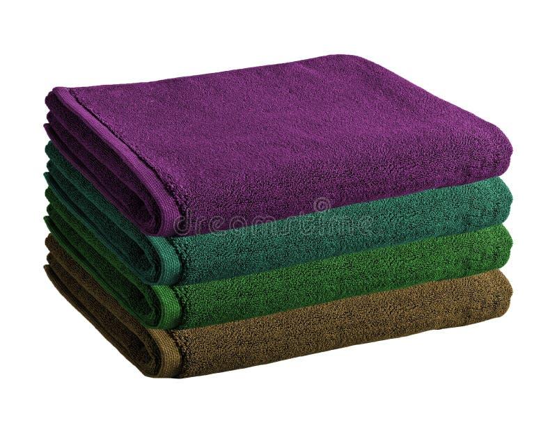 Stapel van gekleurde geïsoleerde handdoeken stock afbeelding