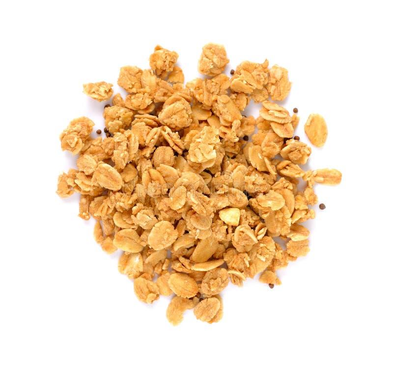 Stapel van granolagraangewas met noten op wit worden geïsoleerd dat stock afbeelding